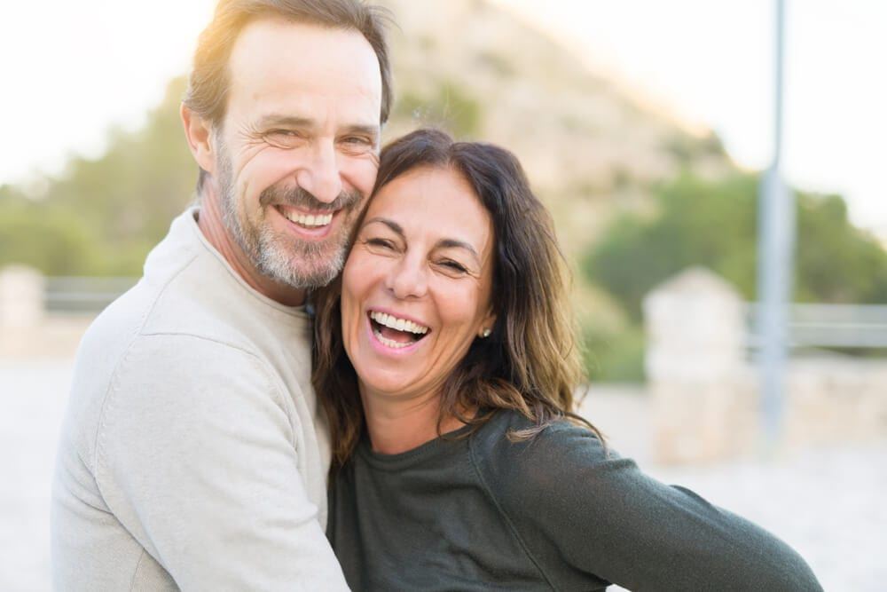 featured imaged for services post, happy couple with bone grafting work